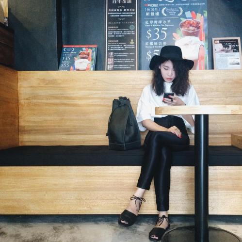 Anaïs Liao grabbing some caffeine in our Desert Sandals.